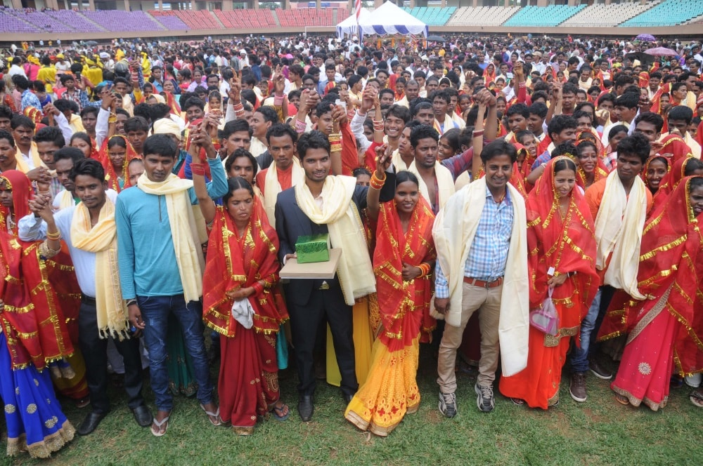 <p>Newly wed tribal couples after mass marriage ceremony organised by Central Sarna Committee at Mega Sports complex Hotwar in Ranchi on Thursday.&nbsp;</p>