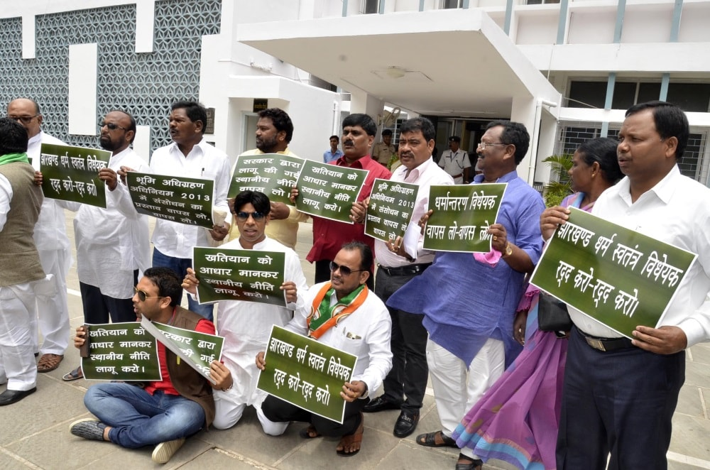 <p>Some members of the Opposition hold placards and raise slogan against the Anti Conversion Bill in assembly yesterday</p>