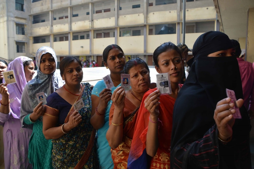 <p>Muslim&nbsp;girls showing their voter ID cards before casting votes during Ranchi Municipal Corporation (RMC) elections at Ranchi on Monday.&nbsp;</p>