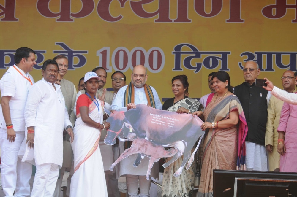 <p>BJP National President Amit Shah distributes cows during &quot;Garib Kalyan Mela&quot; on 1000 days achievements of Government of Jharkhand during a programme in Ranchi on Saturday.&#8230;