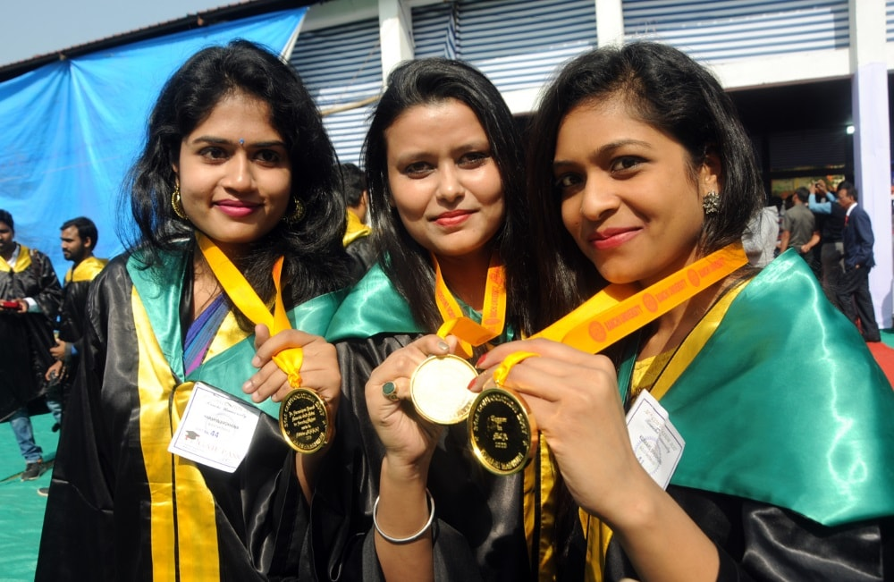 <p>Students celebrate&nbsp;their success by&nbsp;showing medals during the 31st Convocation ceremony of Ranchi University at Dikshant Mandap,in Ranchi on Monday</p>