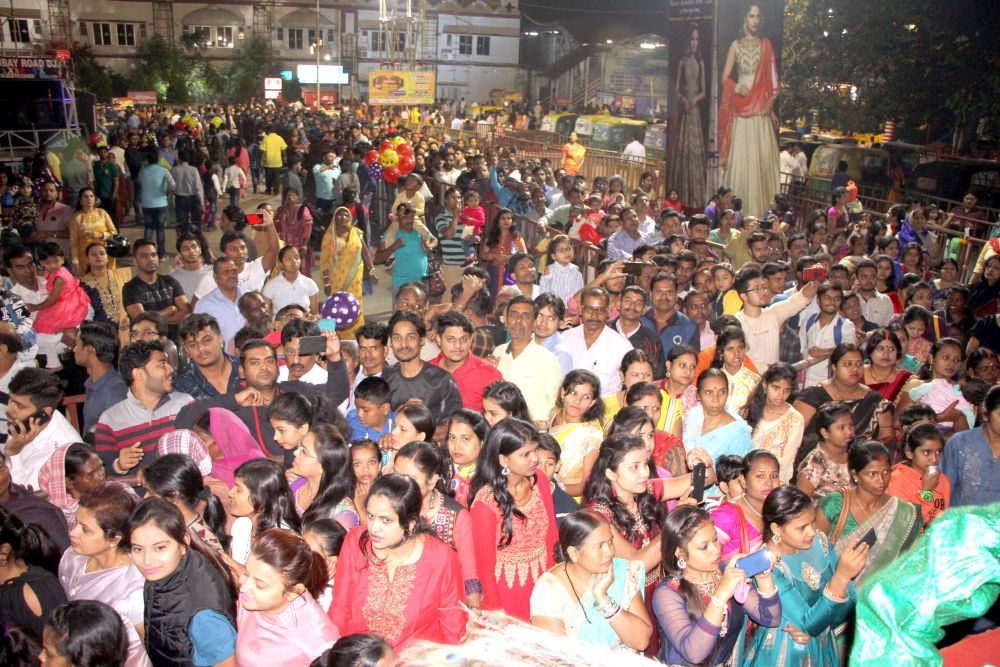 <p>Devotees wait in a queue to offer prayers on the occasion of 'Maha Astami Puja' during the ongoing Durga Puja festival at RR Sporting Club Puja pandal, Ratu Road in…