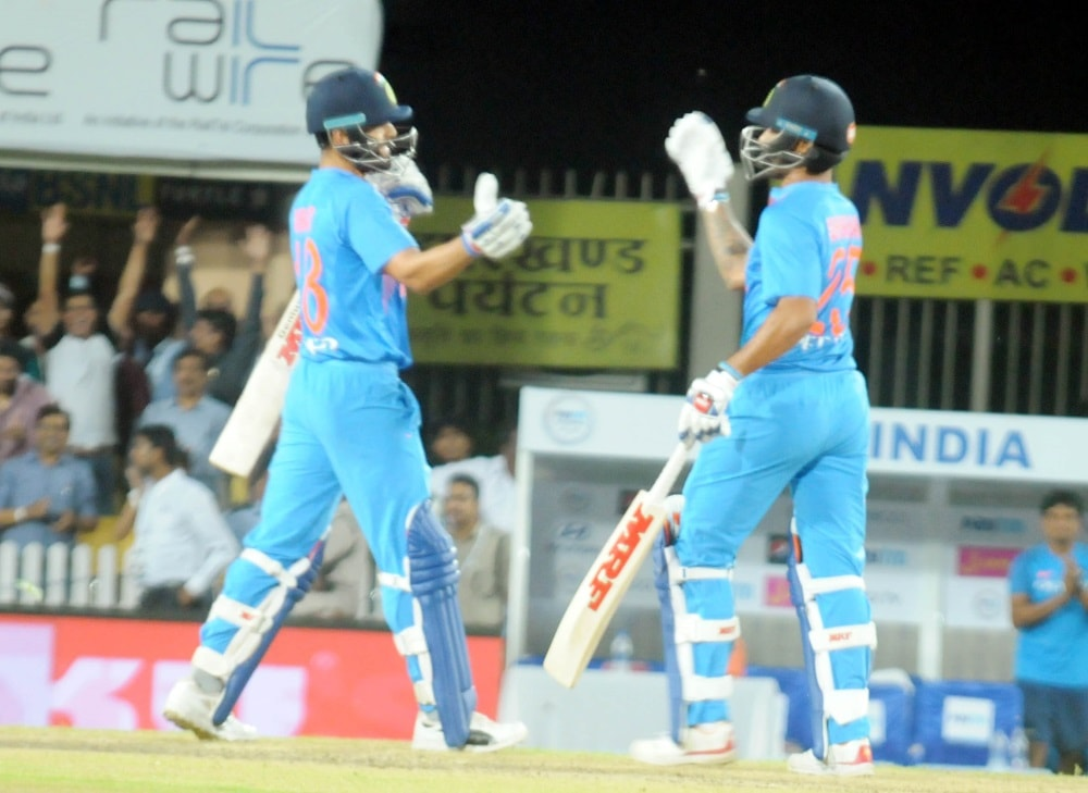 <p>Indian Captain Virat Kohli and Shiker Dhawan greets each other after winning the first T20 match by 9 wickets against Australia at JSCA stadium in Ranchi on Saturday.</p>
