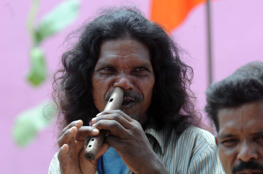 <p>A tribal artist playing Flute with his nose during a programme at freedom fighter Birsa Munda's native village Ulihatu in Khunti district of Jharkhand on Sunday. </p>…