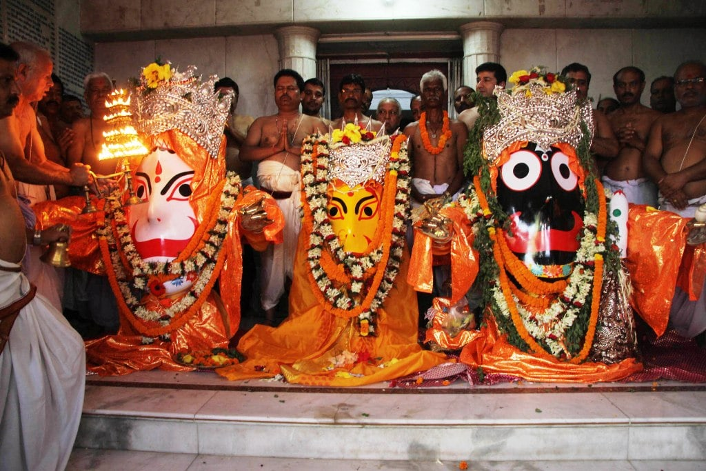 """<p>Priests perform """"Netra Dan"""" rituals of Lord Jagannath, Lord Balabhadra and Goddess Subhadra on the eve of the annual Rath Yatra festival at Jagannath temple in Ranchi…"""