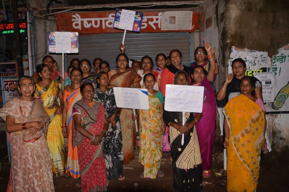 <p>Local residence women protest in front of a liquor shop demanding prohibition on Government run liquor shops in Ranchi on Monday.</p>