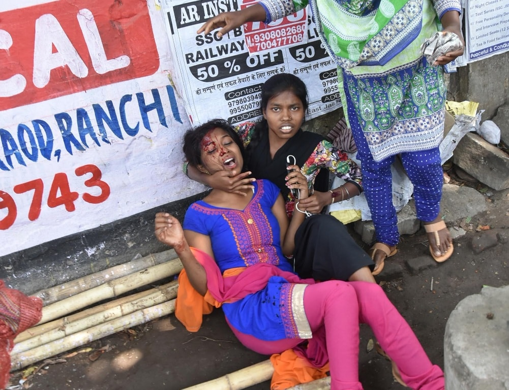 """<p>An injured student is taken care by the fellow students at Women's college science block during """"Bharat Bandh"""" called given by Dalit organisationsin Ranchi on Monday.</p>…"""