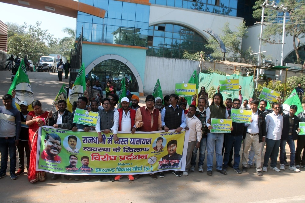 <p>Jharkhand VikasMorcha (JVM) party workers took out a protest rally on Tuesday to protest against the daily occurence of traffic jamon MG Road, Ranchi.</p>