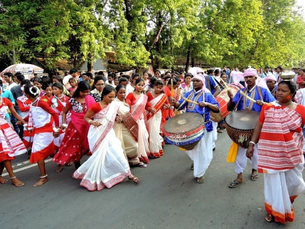 <p>Sarhul celebration in Ranchi where tribal men and women walked, played musical instruments and danced.</p>