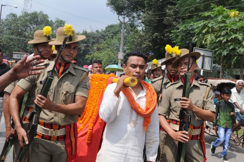 <p>Jharkhand Armed Police forces along with Nepali devotees participate in a Doli Yatra during the seventh day of Navratra festival in Ranchi on Wednesday.</p>