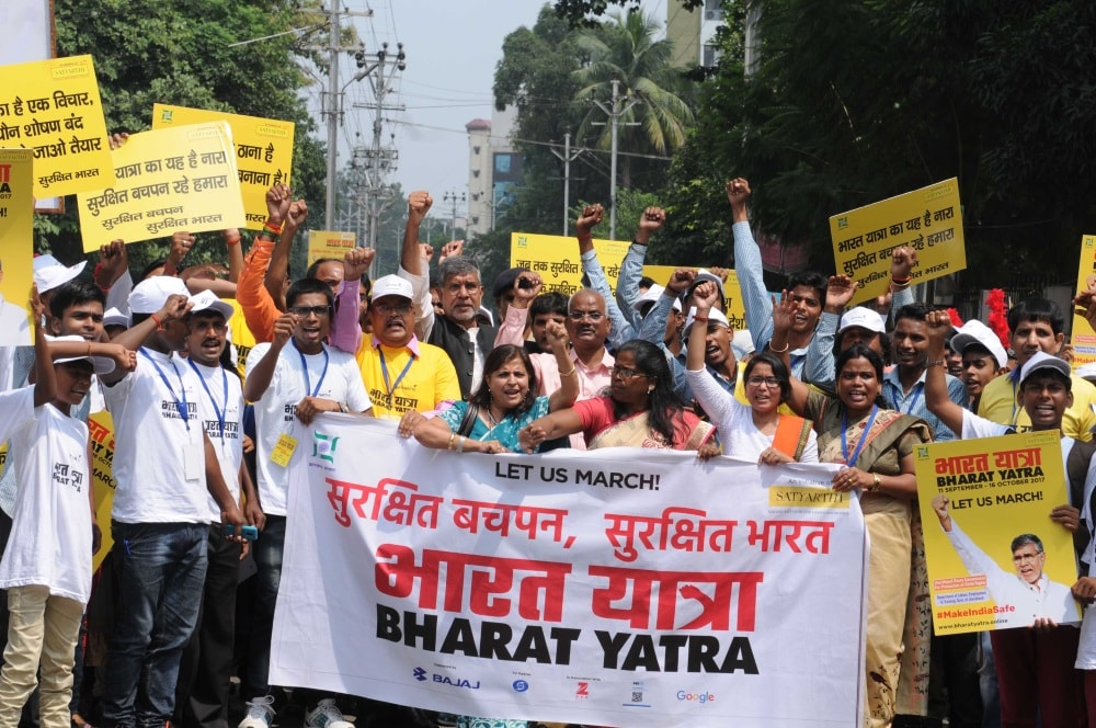 <p>Nobel Peace laureate Kailash Satyarthi along with school children takes part in a Bharat Yatra rally in Ranchi on Monday.&nbsp;</p>