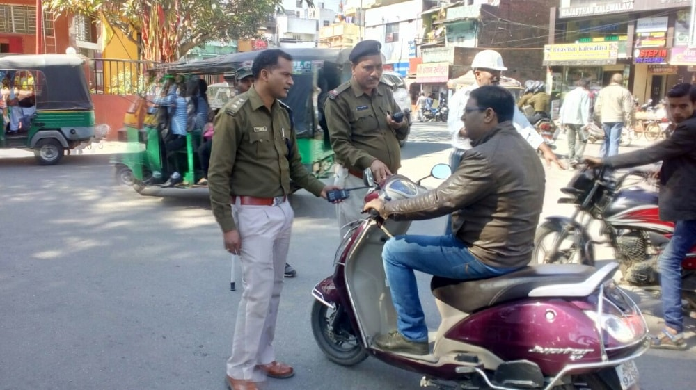 <p>Traffic SP, Dilip Khalko during a campaign against motor cyclists without helmet in Ranchi on Tuesday.</p>