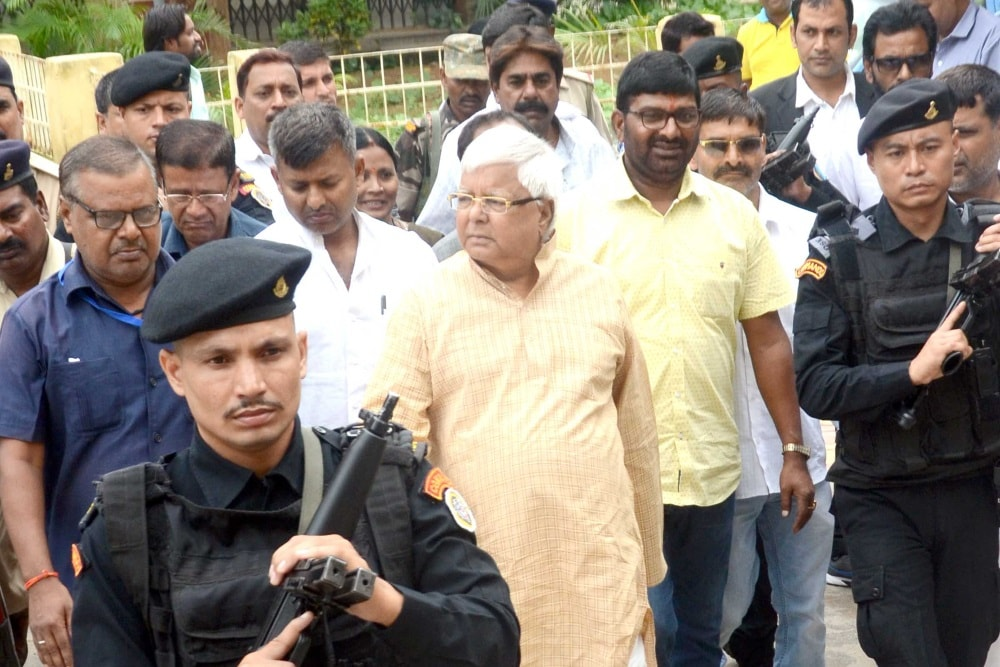 <p>RJD Chief Lalu Prasad Yadav arrives at a special CBI court in connection with multi-crore fodder scam case in Ranchi on Thursday.</p>