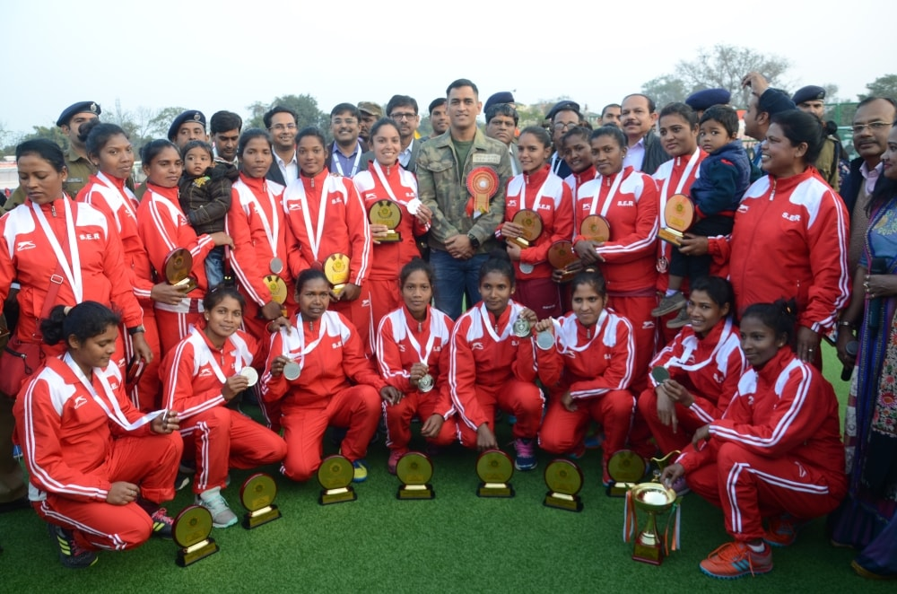 <p>Cricketer Mahendra Singh Dhoni and Central Railway Hockey players pose for photo during concluding day ceremony of the 39th All India Railway Women's  Hockey Championship…