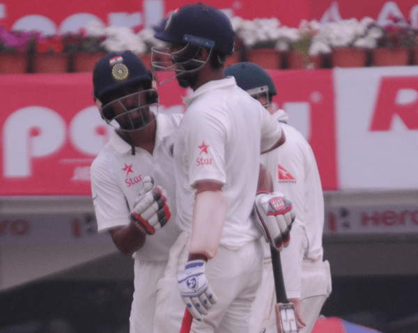 <p>Indian batsman W Saha greets his teammate C Pujara after completing his one and half century (150 runs)against Australia&nbsp;during 4th day of 3rd test match against India at Jharkhand&#8230;