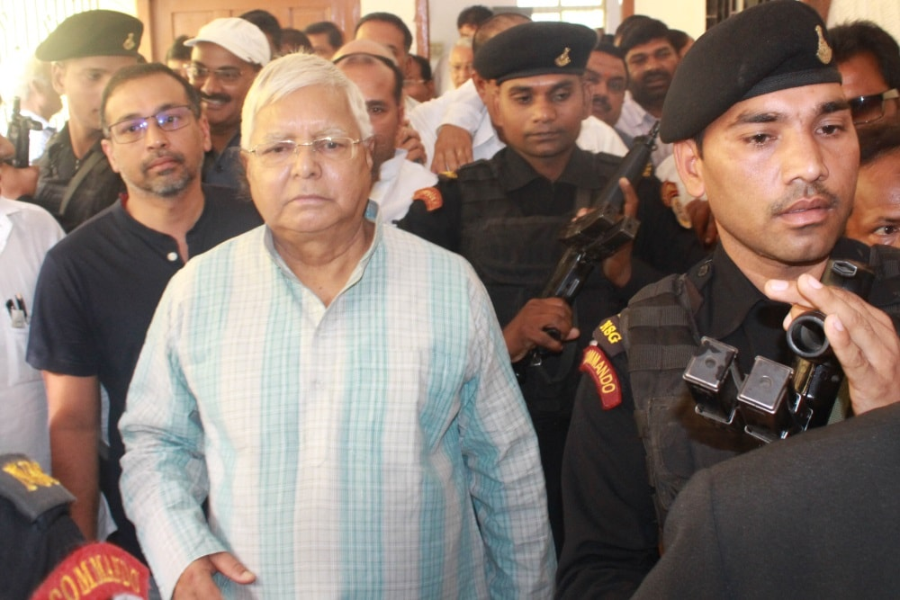 <p>Former Bihar Chief Minister and RJD Supremo Lalu Prasad Yadav arrives at special CBI court in connection with fodder scam cases in Ranchi on Friday.</p>