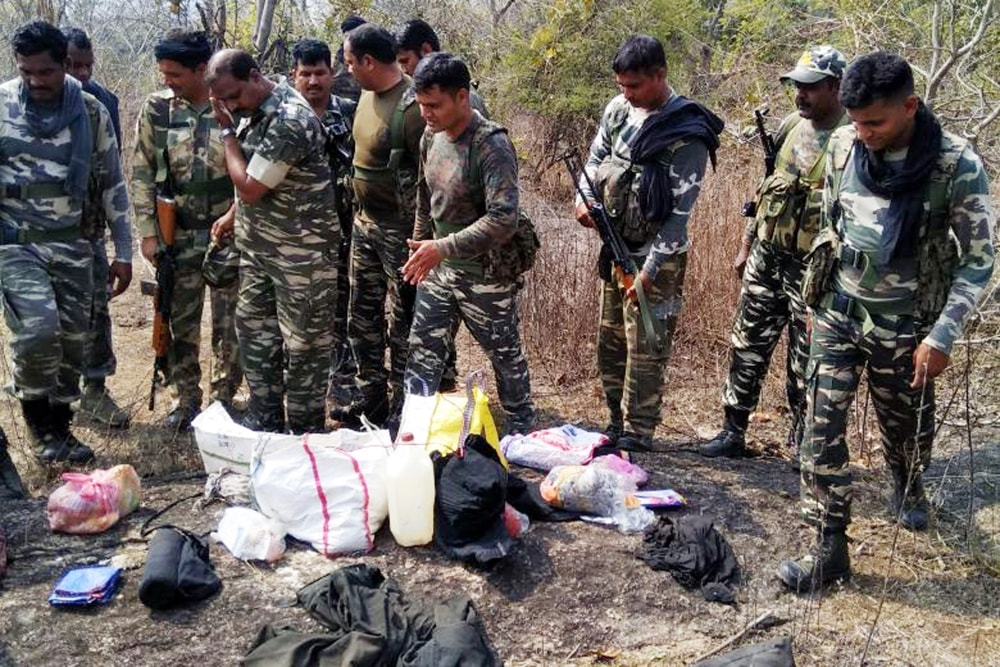 <p>Police personnel inspecting the site where four Naxalites were killed in an encounter with a joint team of the 134 battalion of the CRPF and state police.The team was out on an&#8230;