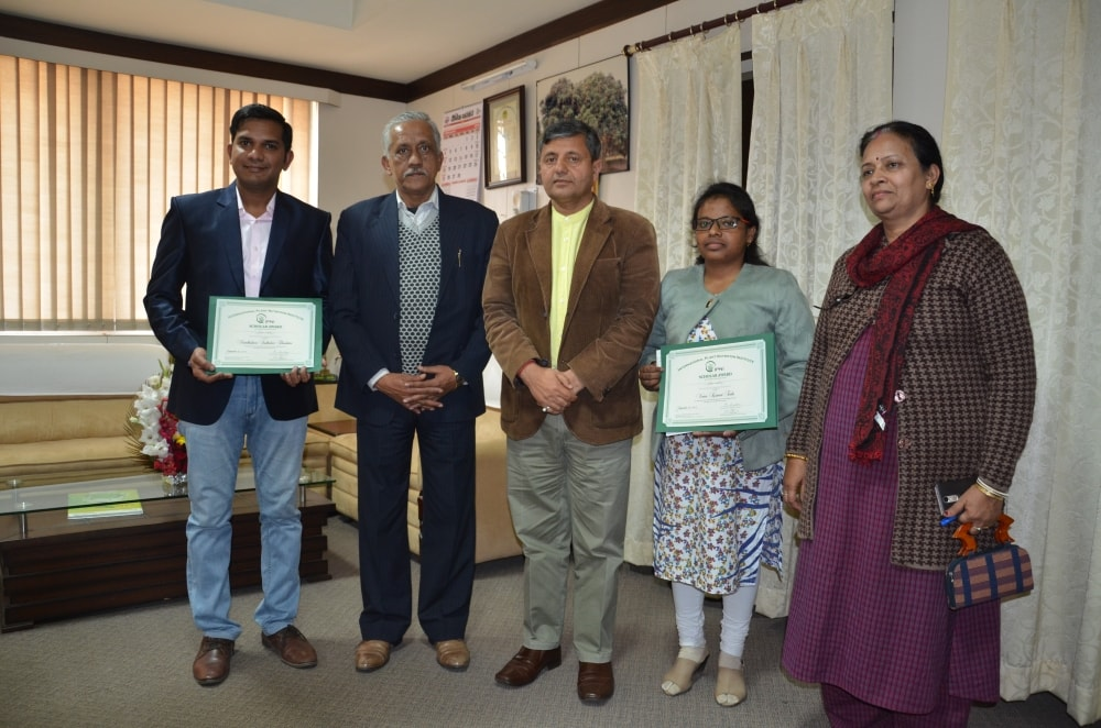 <p>Veena Kumari Tudu and Nand Kishore Thombare showing citations after receiving&nbsp;international award instituted by International Plant Nutrition Institute (IPNI), Georgia, USA&#8230;