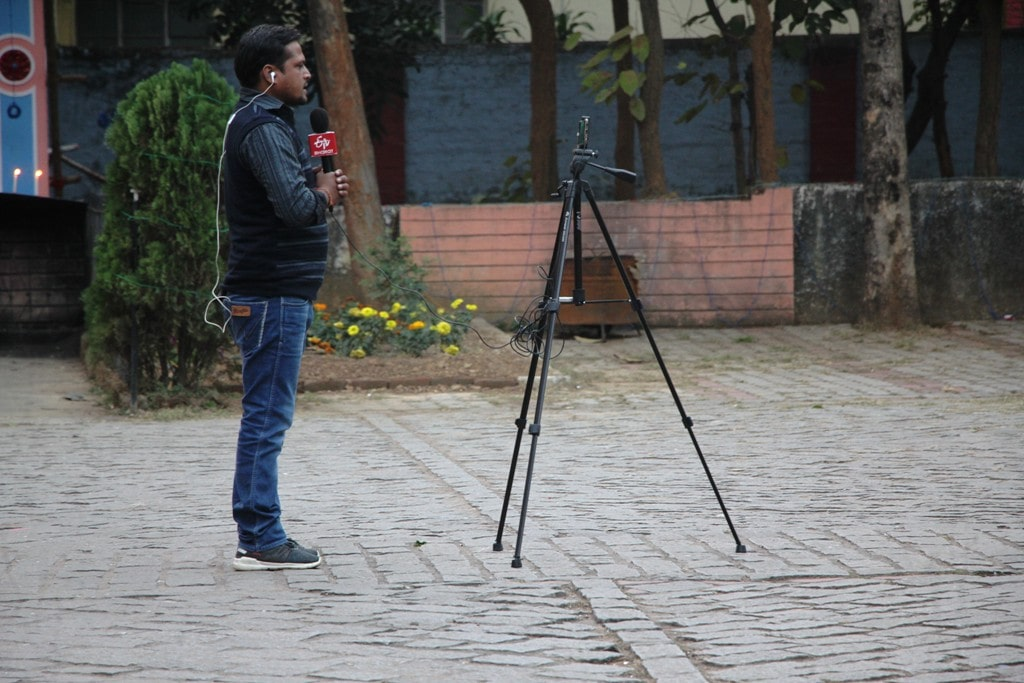 <p>A reporter of a local TV channel offers prayer to Lord Jesus on the eve of X'Mass at a church in Ranchi on Monday.</p>