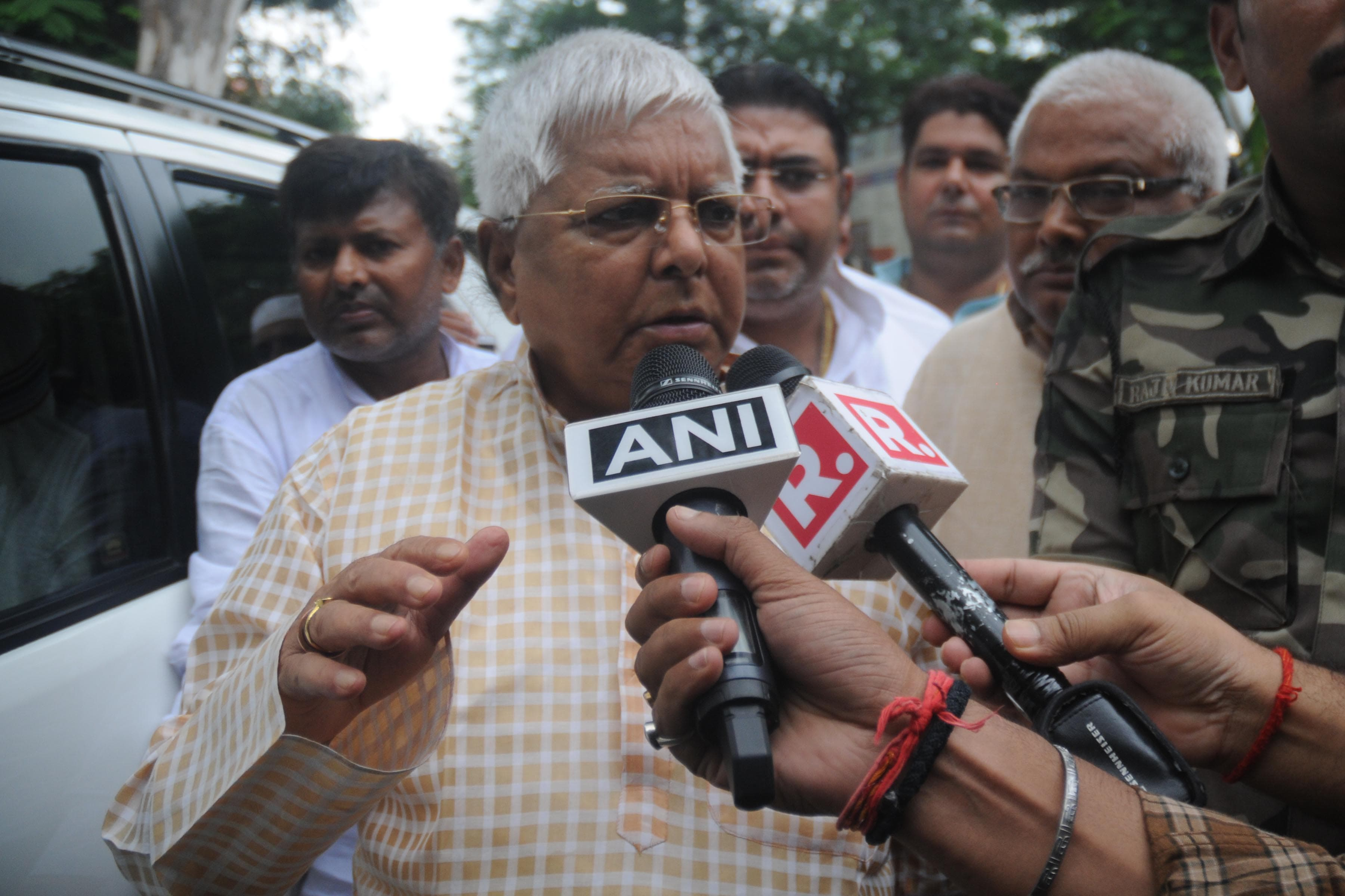 <p>Rashtriya Janta Dal (RJD) leader and former Bihar Chief Minister Lalu Prasad Yadav arrive at Civil court to surrender at the special CBI court in connection with multi-crore fodder…