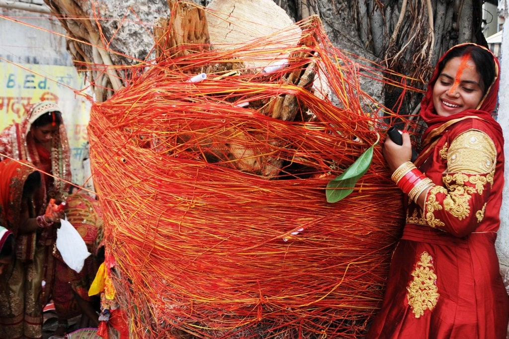 """<p>Married Hindu women tying threads on a Banyan tree for long lives of their husbands on the occasion of """"Vat Savitri Amavashya"""" in Ranchi on Tuesday.Vat Savitri Puja…"""