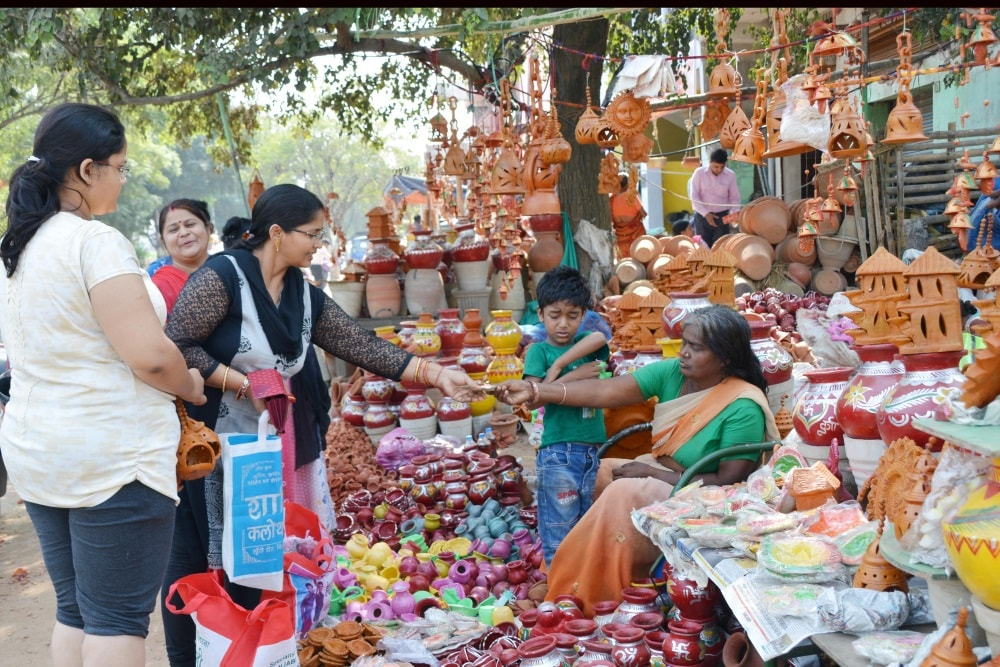<p>Women purchasing home decoration items ahead of Diwali festival at a road side market in Ranchi on Saturday.</p>