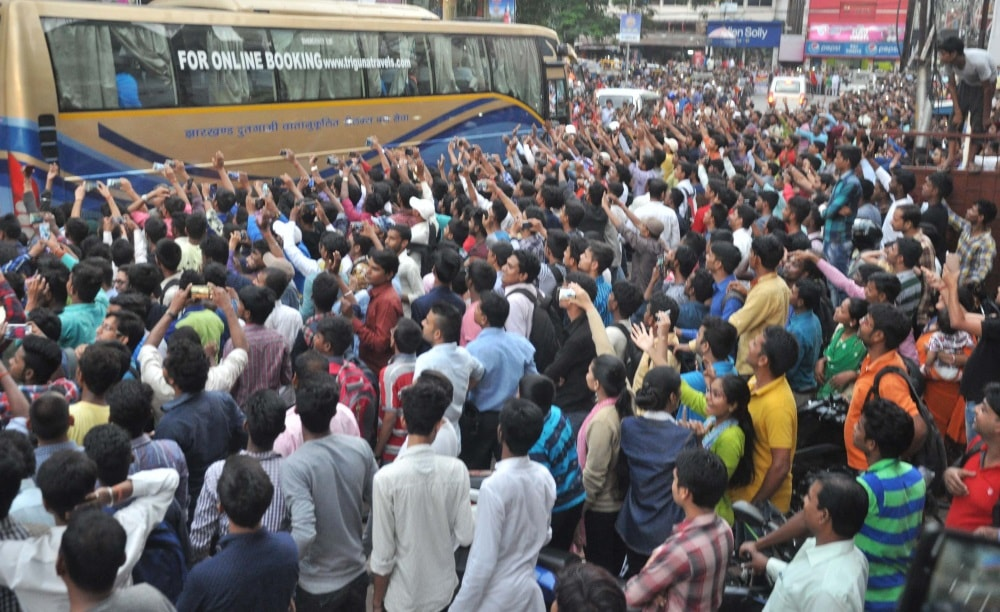 <p>Cricket fans eager to catch &nbsp;a glimpse of their favorite players, gather around the Indian and Australian players service bus before their departure for T20 match in Ranchi&#8230;