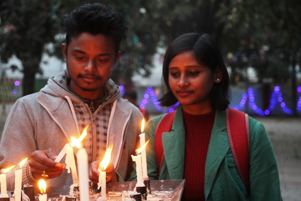 <p>A boy and a girl light candles on the eve of Christmas at a local church in Ranchi on Monday.</p>