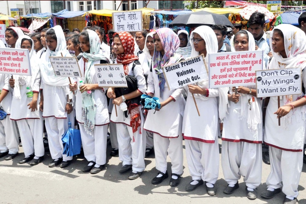 <p>School students hold placards during a silent protest rally against the alleged rape and murder of teenage girls in two separate incidents in past one week in Chatra and Pakur district…