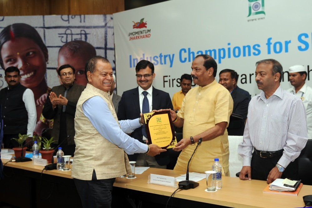 <p>Ex Director of NTPC RK Singh receiving Industry Champions for SDG awards from Chief Minister Raghubar Das during first Corporate Social Responsibility (CSR) award ceremony at Project…