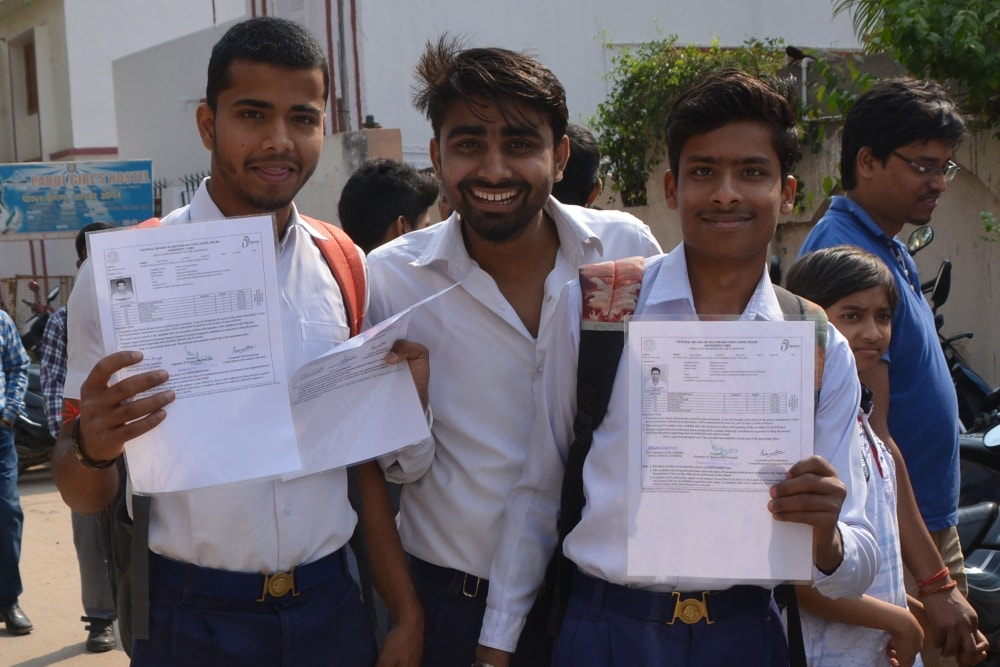 <p>Students showing their admit cards as they arrive at a center for appearing in the CBSE board examinations in Ranchi on Monday.</p>