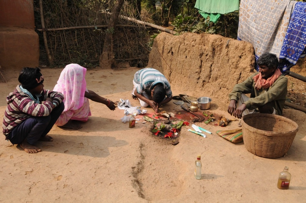 <p>Sawna Hembrom performs puja for well being of the patients at his home at Langopade village near Dumka of Jharkhand in India.</p>