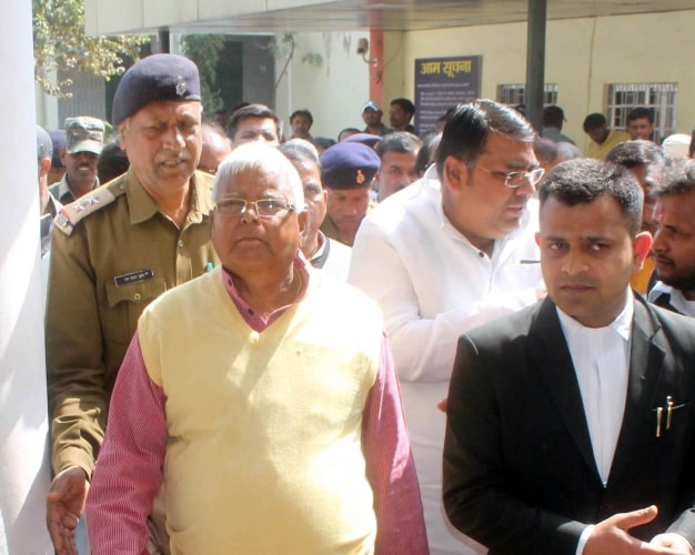 <p>Former Chief Minister of Bihar Lalu Prasad Yadav under police custody arrives at the special CBI court in Ranchi from Birsa Munda jail on Tuesday.</p>