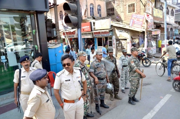 <p>Police personnel vigil second day of clash between two communities at Main road in Ranchi on Wednesday. </p>