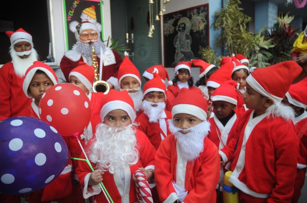 <p>Sherwood (N) Public School children dressed up as Santa Claus attending their class celebrating Christmas festival in Ranchi on Friday.</p>