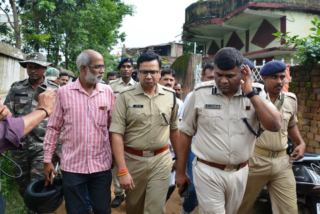 <p>Ranchi Range Deputy Inspector General of Police A.V. Homkar with SSP Ranchi Anish Gupta emerge after carrying out investigation from the house where seven members of a family allegedly…