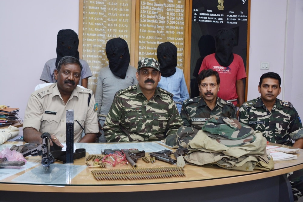 <p>Rural Superintendent of Police&nbsp; Raj Kumar Lakra (L), ASP operations RC Mishra (2nd_R), Deputy Commandant operation Anuj Kumar (R) and other senior officials showing four arrested&#8230;