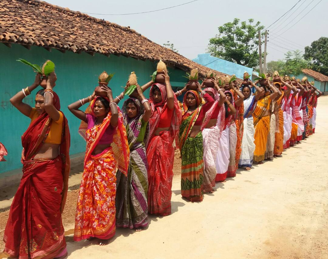 <p>The women of Bedamundui panchayat in Jharkhand walked for one and half KM,carrying earthen bottles of water to observe Satyanarayan Puja.They are slated to participate in Kalash…