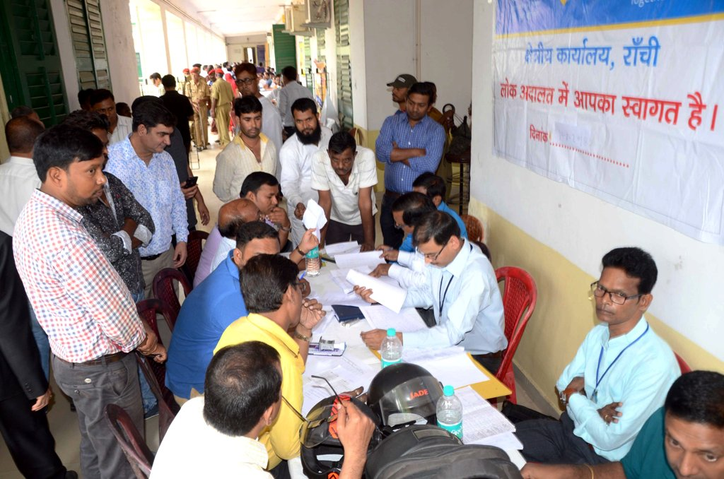 <p>Lawyers solving the cases of people during Mega National Lok Adalat at Civil court in Ranchi on Saturday.</p>