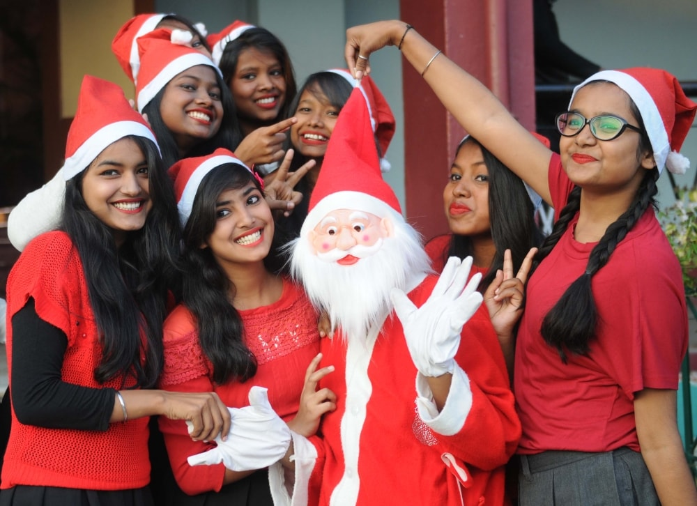 <p>Ursuline Inter college students celebrating with Santa Claus ahead of Christmas festival in Ranchi on Thursday.</p>