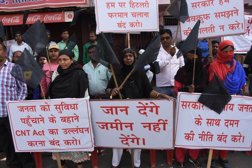 <p>Local people protest by showing placards and shouting slogans against the construction of proposed Kantatoli flyover in Ranchi on Monday.</p>