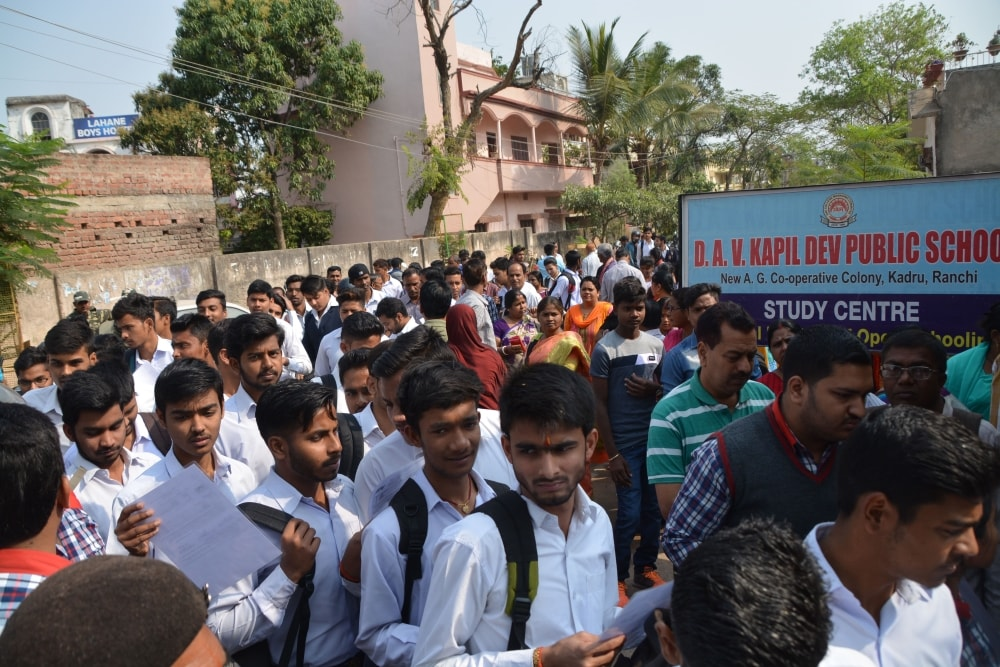 <p>Students arrives at a center for appearing in the CBSE board examinations in Ranchi on Monday.</p>