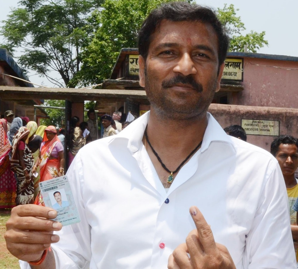 <p>Former Jharkhand Deputy Chief Minister and AJSU Party Chief Sudesh Mahato, show his ink-marked finger after casting his vote at a polling station in Silli 63 KMs from Ranchi on…