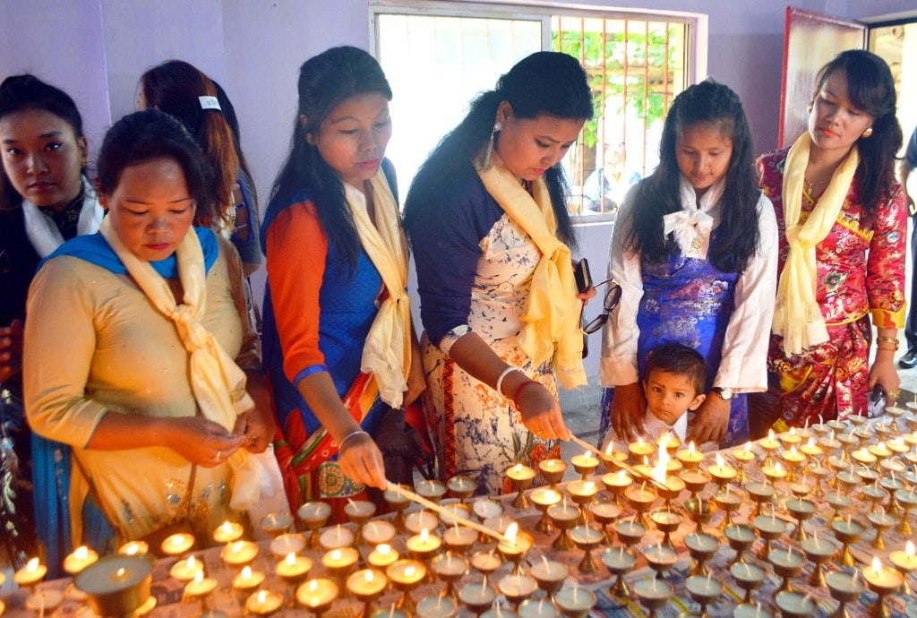 <p>Buddhist devotees light lamps on the occasion of Buddha Purnima at JAP-1 Doranda in Ranchi on Monday. The festival marks the triple events of Gautam Buddha's life- his birth,…
