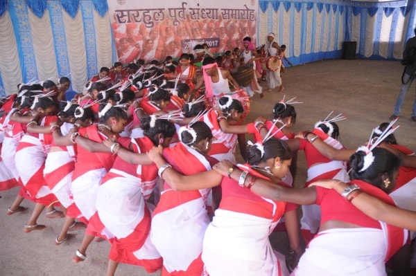 <p>Adivasi students performs cultural programme on the eve of the Sarhul festival, the festival of flowers among the tribals of eastern India in Ranchi on Wednesday.</p>