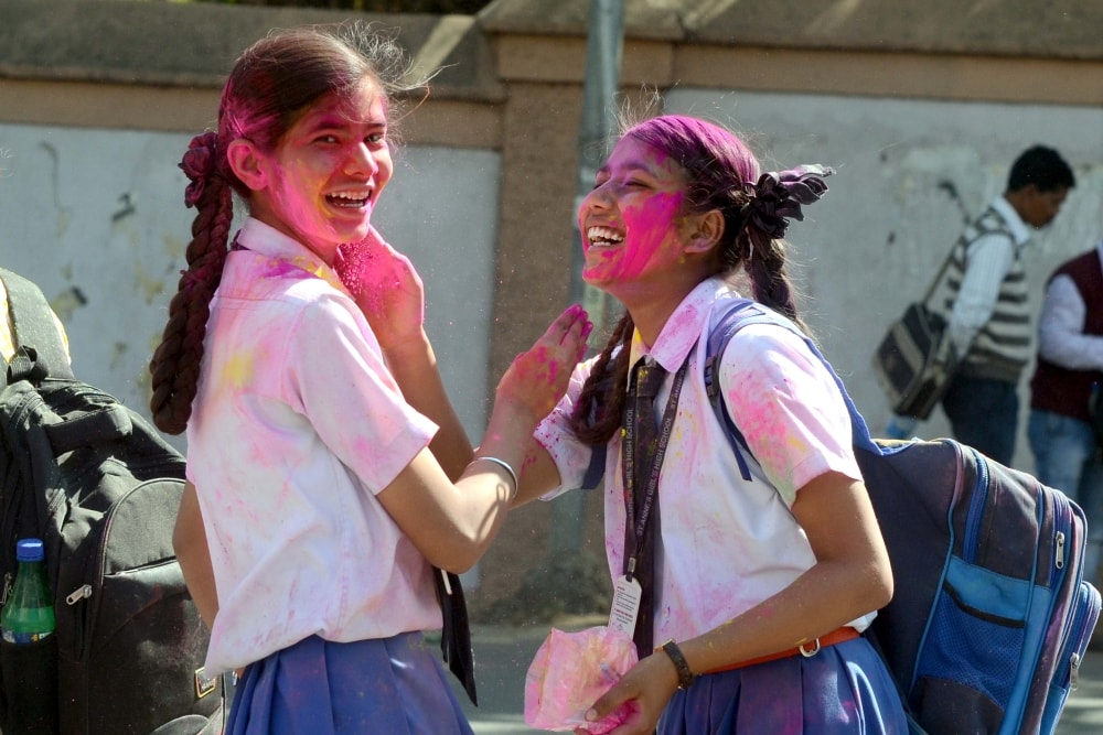 <p>College students play with 'Gulal' ahead of Holi festival  in Ranchi on Wednesday. </p>
