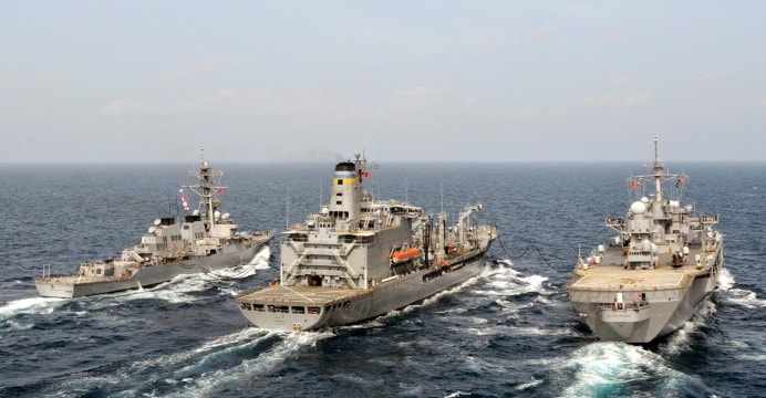 US Guided Missile Destroyers, Aircraft Carrier sail with Indian Navy's Frigate in Indian Ocean