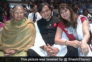 BJP's women cadres bang Tharoor's car,leaving wife upset