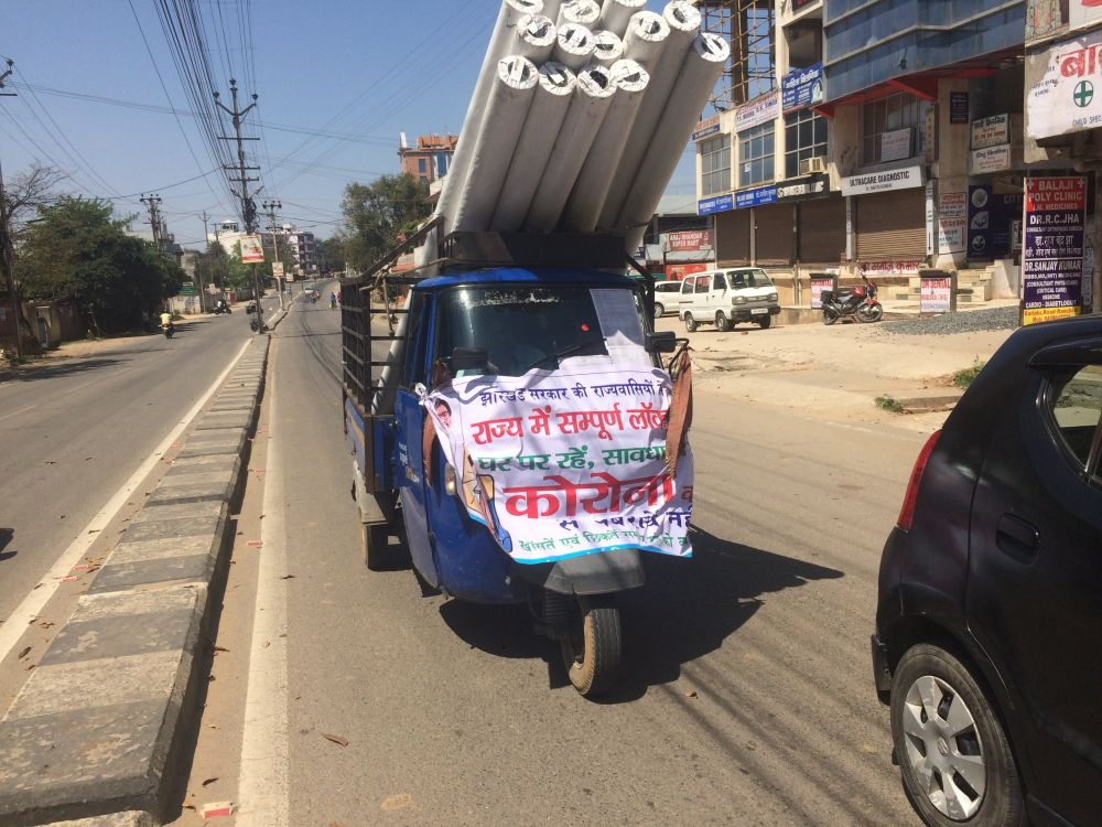 moving-tempo-with-covid-19-posters-in-ranchi
