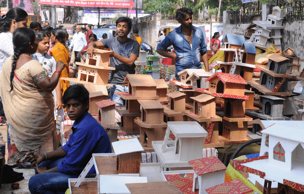 <p>People buying Gharondaahead of Diwali festival from a road side stall in Ranchi on Tuesday.</p>